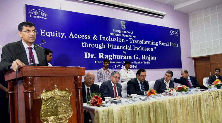 Hyderabad: RBI Governor Raghuram Rajan addressing the National Seminar on 'Equity, Access & Inclusion-Transforming Rural India through Financial Inclusion' along with W R Reddy, Director General NIRD PR and Vikas Singh, President Crux at Vikas Auditorium in Rajendranagar near Hyderabad on Monday. PTI Photo(PTI7_18_2016_000024A)