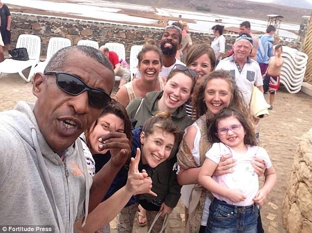 Father-of-five looks so much like Obama he gets mobbed for selfies everywhere he goes