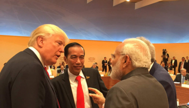 Trump walks up to Modi to chat